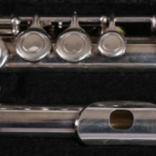 A flute in sections stored in a case.