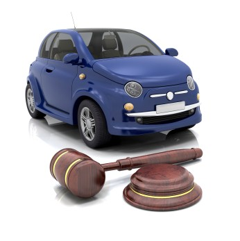 Buying a Car at Auction, Car for Auction With Gavel in Foreground
