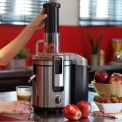 Woman juicing fruits