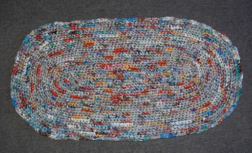Multicolored crocheted oval rug.