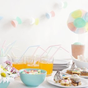 Decorations and food on a table at a baby shower.