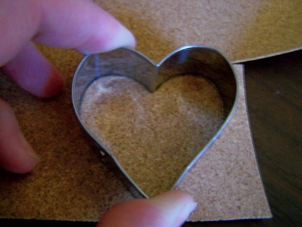 small metal heart cookie cutter placed on top of cork