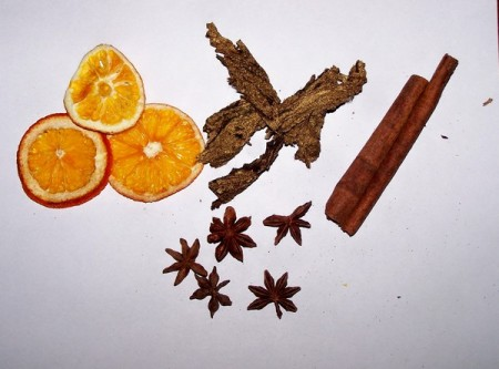 Dried oranges, cinnamon sticks, star anise, dried cinnamon flowers