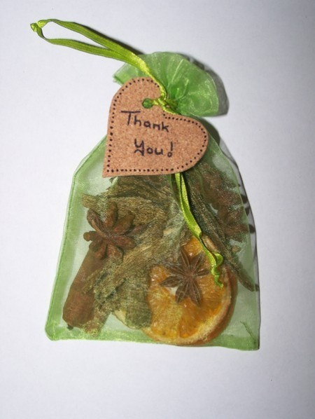 Green mesh potpourri bag filled with potourri, heart cork attached