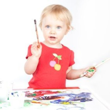 Little girl painting.
