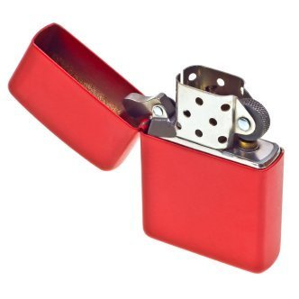 Red Zippo lighter on a white background.
