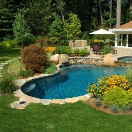Lanscaping around a swimming pool.