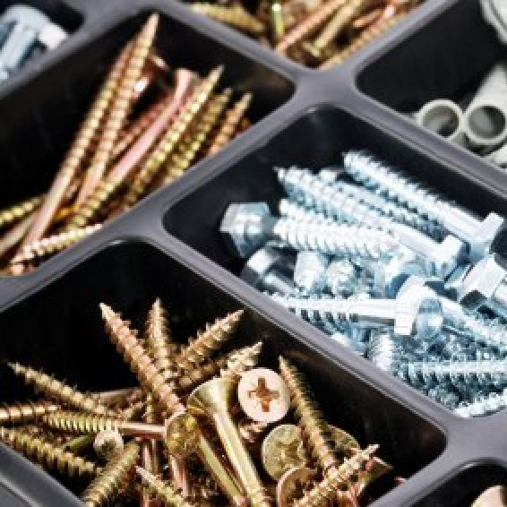 Screws stored in a compartment tray.