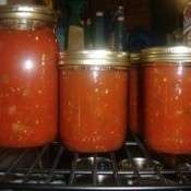 Jars of homemade canned tomato salsa.