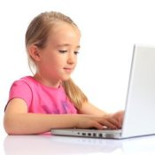 Protecting Your Children on the Internet, A young girl using a laptop.