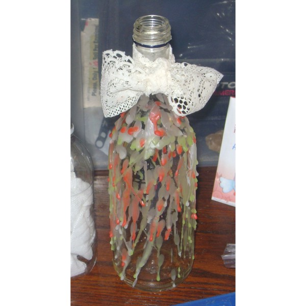 Recycled glass bottle decorated with dripped wax.