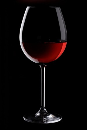 Red Wine in Crystal Glass on Black
