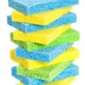 Stack of blue, yellow, and green sponges.