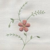 Floral needlework on white fabric.