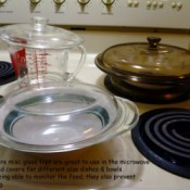 Glass lids on top of measuring cup and other bowls.