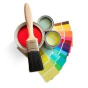 Cans of house paint, paint chips, and a paint brush.