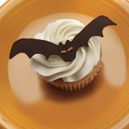 A bat decoration on top of a cupcake.