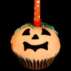 Cupcake decorated as a jack-o-lantern.