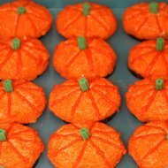 Cupcakes decorated as pumpkins.