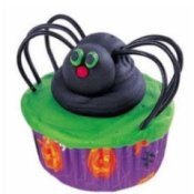 Black spider cupcake with colorful frosting.