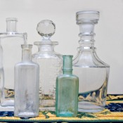 A collection of antique glass bottles.