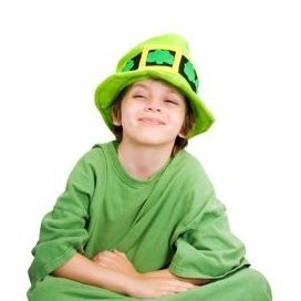 Boy Sitting Cross Legged in Leprechaun Costume