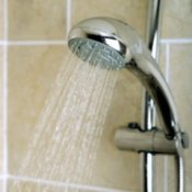 Shower head with the water running.