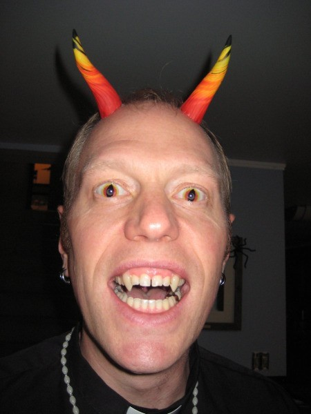 man with Devil horns and fangs