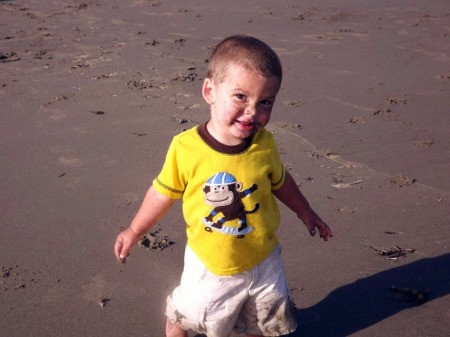 Boy with Yellow Shirt and Sand on His Face