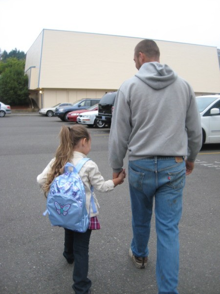 Father and Daughter off to the First Day of School