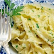 Fettuccine Alfredo on a blue and white plate.
