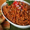 Baked beans in a white bowl.