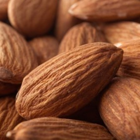Up close photo of whole almonds.