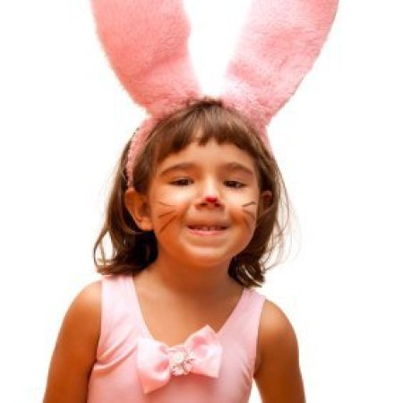 Young girl in a pink bunny costume.