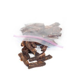 Pieces of beef jerky spilling out of a plastic storage bag.