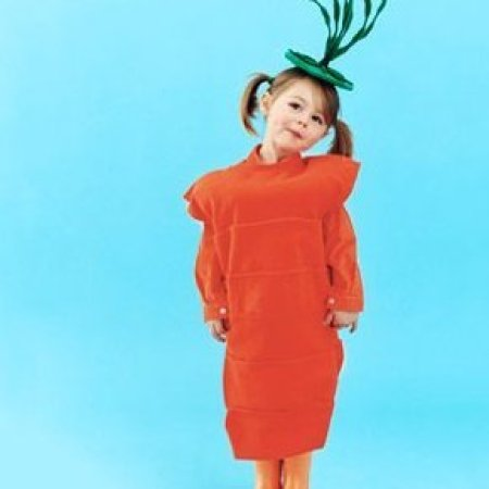 Young girl in a carrot costume.