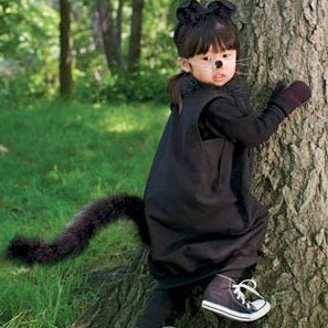 Little girl in a black cat costume.