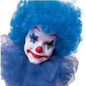 Child in a blue clown wig and face paint.