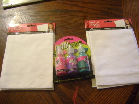 Package of puffy paint and two packages of white bandanas.