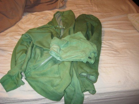 Clothes Laid Out on bed After Being Dyed Green
