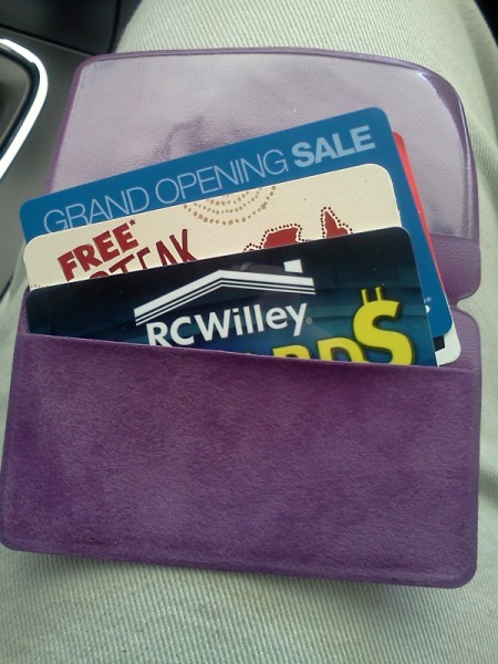 Purple pill pouch with gift cards inside.