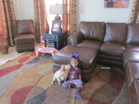 Sugar the Dog sitting on Floor With Little Girl