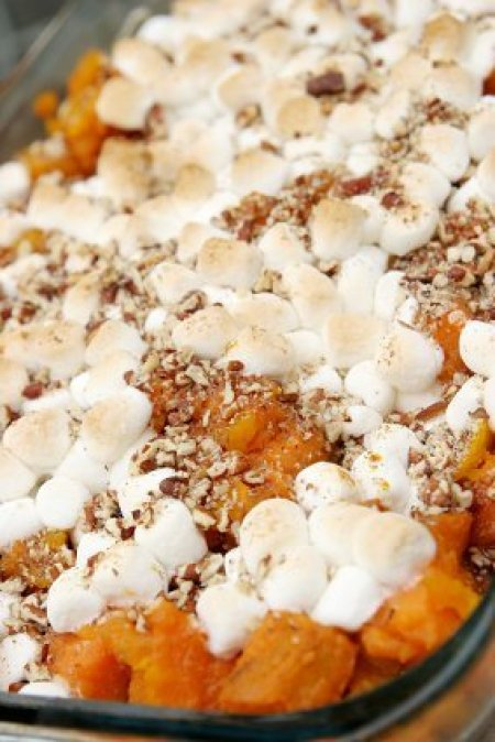 A traditional sweet potato casserole topped with marshmallows.