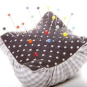 Fabric pincushion with polka dot top and gingham base