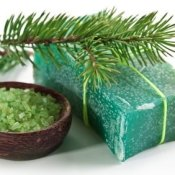 Making Homemade Soap, Bar of natural pine soap, with a pine branch, and a dish of green sea salt.