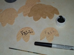 Writing Fall on the paper leaves and applying the dots.