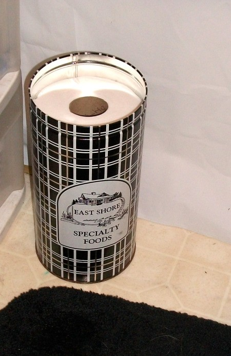 Decorative tin used for extra TP storage.