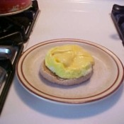 Finished McMuffin on a plate.