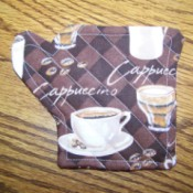 Coffee cup coaster in the shape of a coffee pot.