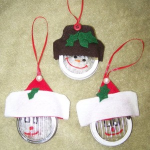 Christmas ornaments made from jar rings. There are two Santas and snowman ornament.
